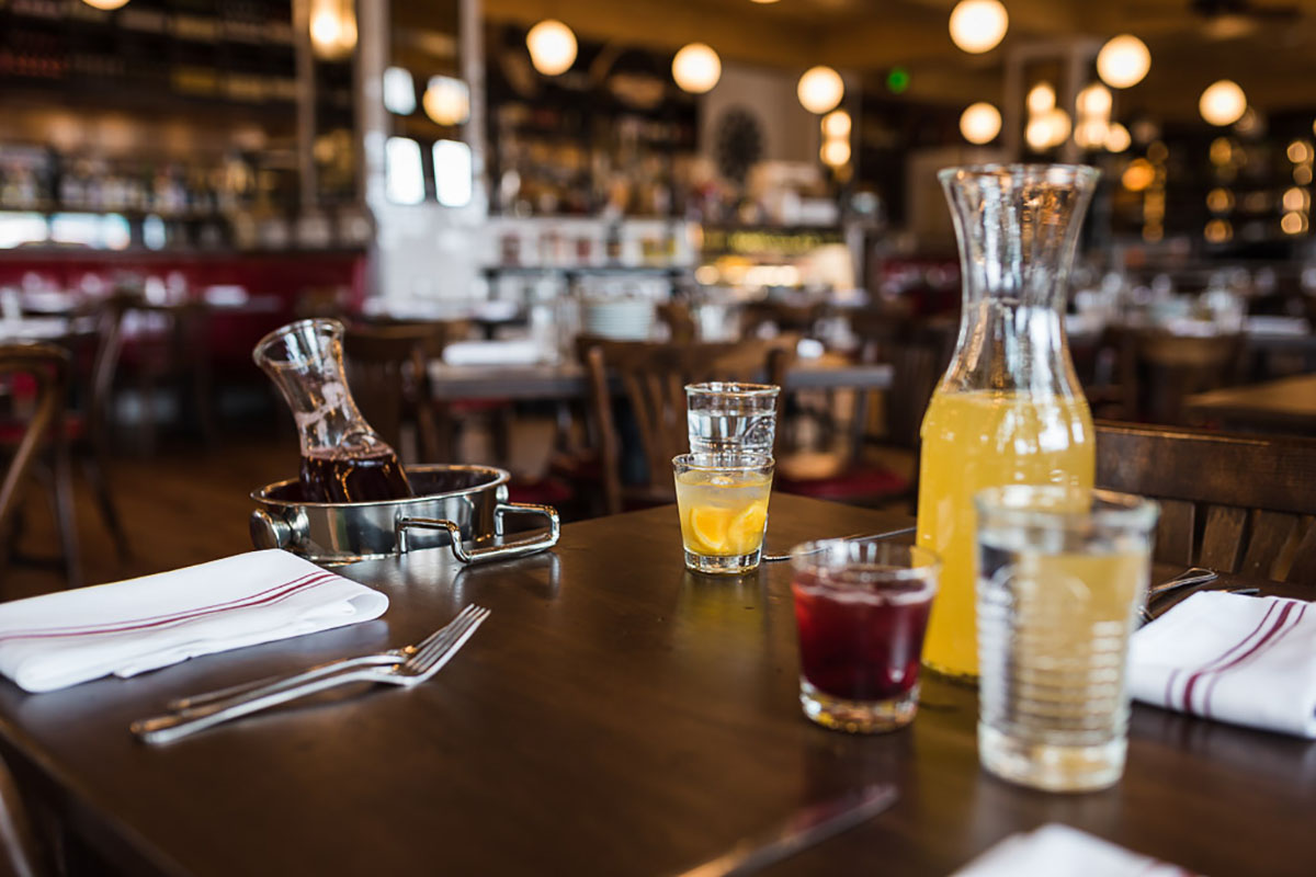 Marcella's Denver interior and table with brunch drinks